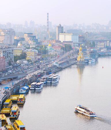 vertica: View of Kiev Podol embankment and river port. Ukraine