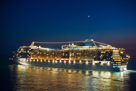 Cruise liner at night under the new moon Stock Photo
