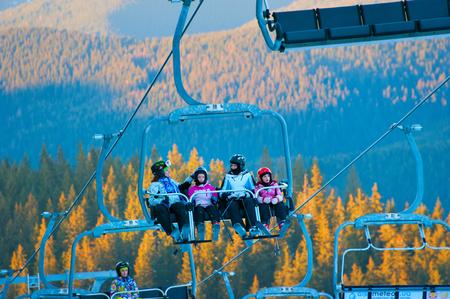 kids at the ski lift: BUKOVEL, UKRAINE - DEC 08, 2105:Women with childrens on a ski lift in Bukovel. Bukovel is the most popular ski resort in Ukraine.