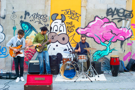 amp: PORTO, PORTUGAL - NOV 13, 2016: Music band playing on the street. Porto famous tourist destiantion in Portugal