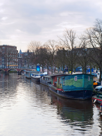 Houseboats om Amsterdam canal in Old Town. Netherlands