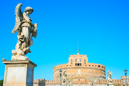 castel: St. Angelo castle with statues on St. Angels bridge on foreground. Rome, Italy