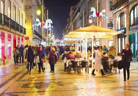 LISBON, PORTUGAL - DEC 07 , 2016: People on Augusta street with Cristmas and New Year decoration. Augusta street is a famous tourist attraction in Lisbon