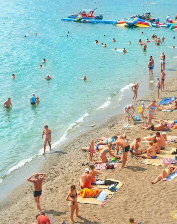 SUDAK, UKRAINE - SEPT 08, 2015: People at a sea beach in Sudak. Editorial