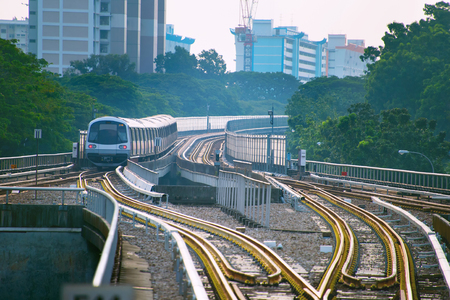 Singapore MRT train on a railroad at sunset 版權商用圖片