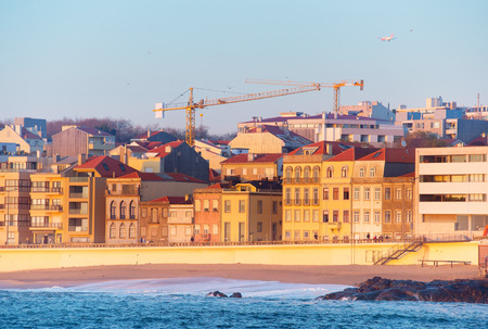 Airplane flying above the Matosinhos - Porto luxury district. Portugal