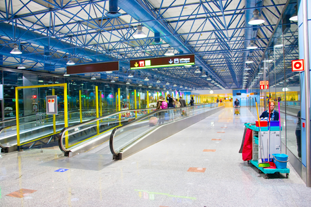 barajas: MADRID, SPAIN - DEC 26, 2016: Cleaning service in Madrid–Barajas Airport. About 50.4 million passengers used the airport in 2016 making it the countrys largest and busiest airport Editorial