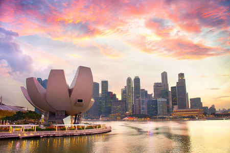 Skyline of Singapore Downtown with beautiful sunset clouds over it Stok Fotoğraf
