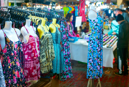 Woman dresses for sell at night market. Chiang Mai, Thailand