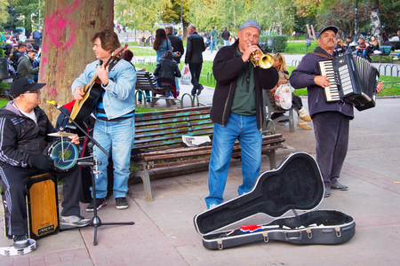 busker: SOFIA, BULGARIA - OCTOBER 16, 2016: Music band playing on the street of Sofia, Bulgaria. Sofia is the capital of Bulgaria. Editorial