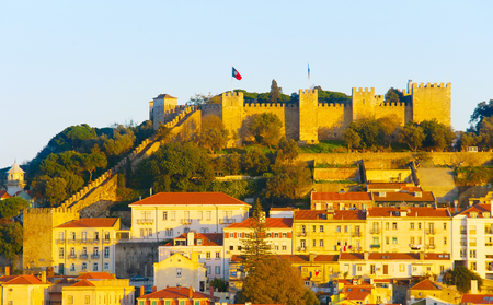 Lisbon Castle on a top of a hill at sunset. Lisbon, Portugal Stock Photo