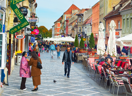 famous people: BRASOV, ROMANIA - OCT 07, 2016: People on Old Town street of Brasov. Brasov is a city in Romania and the administrative centre of Brasov County. Famous tourist destiantion.