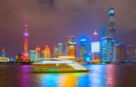 famous industries: River cruise ship in front of Shanghai downtown. China