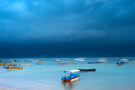Lots of fisher boats in the ocean in the strom. Bali island, Indonesia