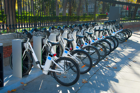 Bycicle for rent in the park. Madrid, Spain Stock Photo