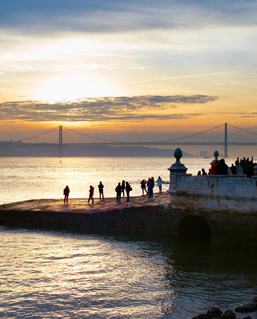People watching sunset on Lisbon quay. Portugal