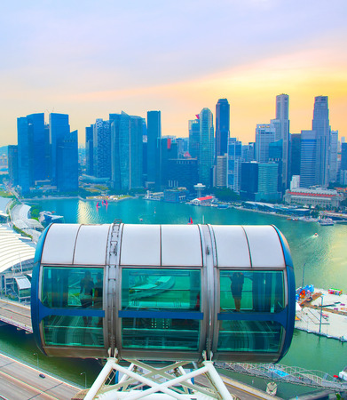 Singapore Flyer cabin and Singapore Downtown Core on the background