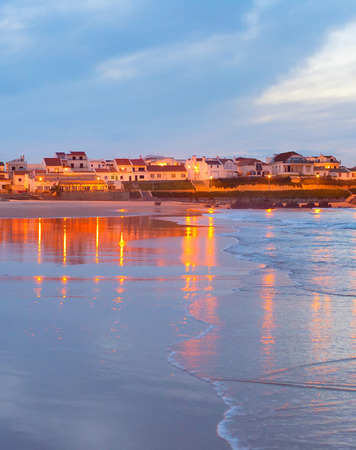 water town: Town on the ocean shore reflected in the water. Portugal Stock Photo