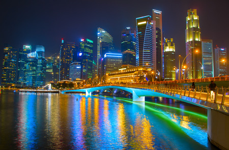 Singapore Downtown reflected in a river at night