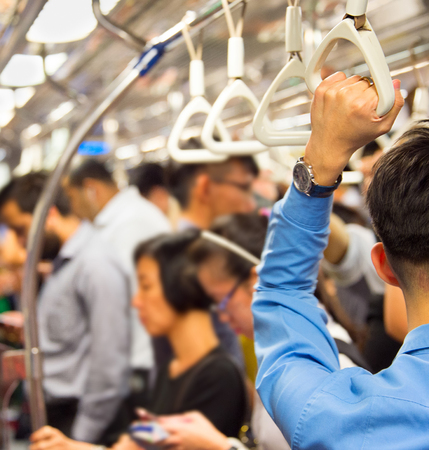 People in the crowded metro train in Singapore