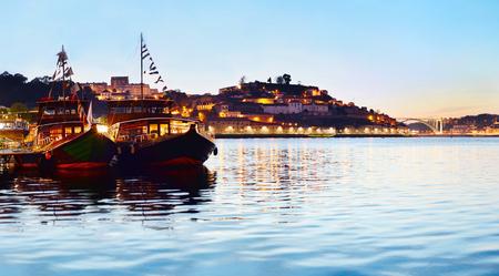 river: Portuggese boat at twilight in Villa Nova de Gaia. Portugal