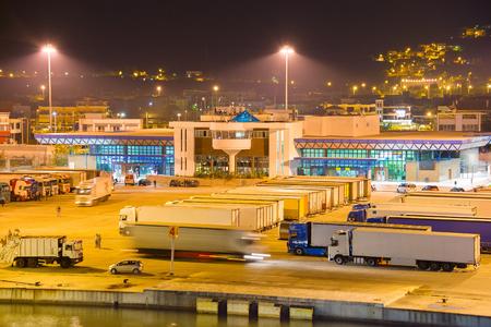 Lots of trucks in sea port at night. Igoumenitsa, Greece
