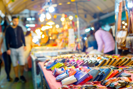 Wallets and souvenirs for sell at night market. Chiang Mai, Thailand 版權商用圖片