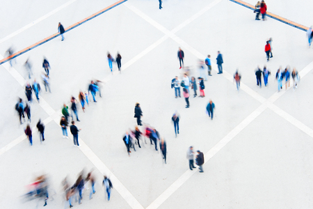 Motion blur of many people. View from above