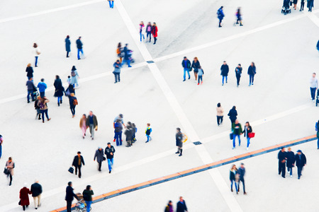 Crowd of people at a public square. Long exposure. Motion blur. Aerial view Stock Photo