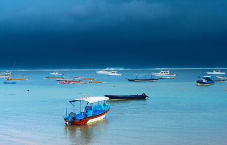 typical: Fisherman boats in the ocean. Bali island, Indonesia Stock Photo