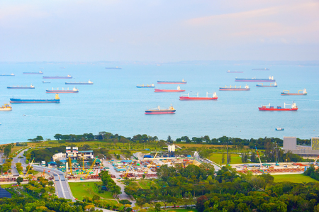 Lots of industrial cargo ships in Singapore harbor Stock Photo