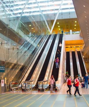 SINGAPORE - JAN 13, 2017 : Escalators at Changi International Airport in Singapore. Changi Airport serves more than 100 airlines operating 6,100 weekly flights