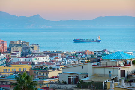 Tanker full of containers in arrive to Naples sea port. Italy