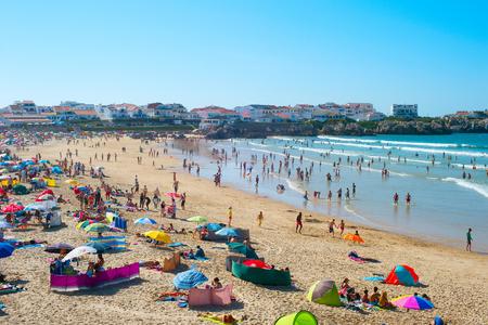 BALEAL, PORTUGAL - JUL 30, 2017: Crowded ocean beach in a high peak season. Portugal famous tourist destination for it's ocean beaches.