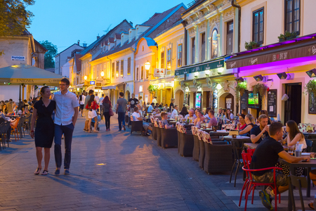 ZAGREB, CROATIA - AUG 25, 2017: Locals and tourists having a dinner at restaurants at Ivana Racica street. Zagreb is a capital and famous tourist destination in Croatia Redakční