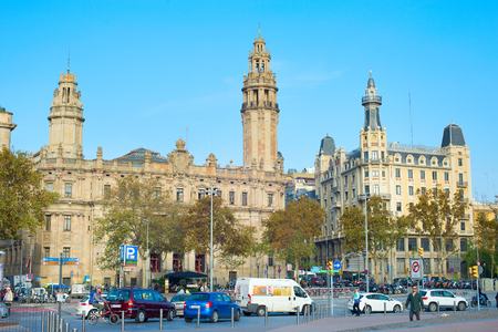 BARCELONA, SPAIN - NOVEMBER 3, 2016: Road traffic in front of famous  famous central Post Office building in Barcelona. The central post office is located in Via Laietana street