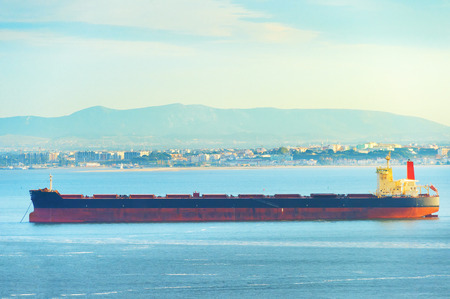 Large cargo shipping tanker on Tagus river in Lisbon, Portugal 版權商用圖片