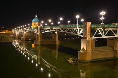 Saint-Pierre Bridge and Hopital de la Grave at night. Toulouse, France