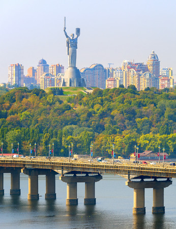 Paton bridge over the river Dnieper, Mother Motherland monument in Kiev, Ukraine Stock fotó