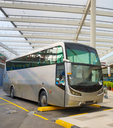 Bus on a parking lot at airport terminal. Singapore
