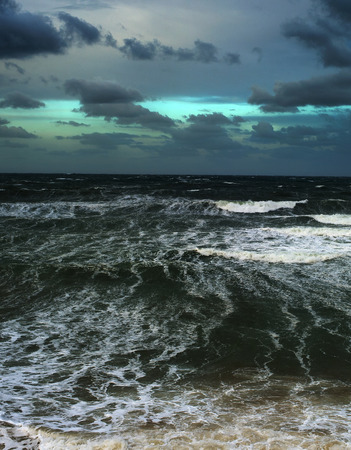 Stromy ocean with heavy clouds in the day. Portugal