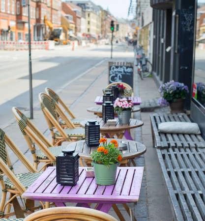 Street cafe near the road. Copenhagen, Denmark