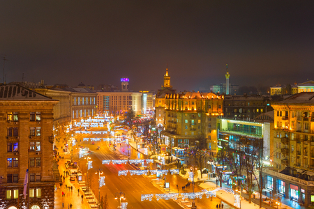 Evening Kiev cityscape with illuminated Khreshatyk street in downtown aerial view, Ukraine