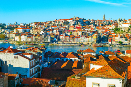 Porto cityscape with old town by Douro river in morning sunshine, Portugal