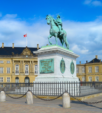 Equestrian statue of Frederik V by Amalienborg courtyard architectural building in sunny day, Copenhagen, Denmark Editoriali