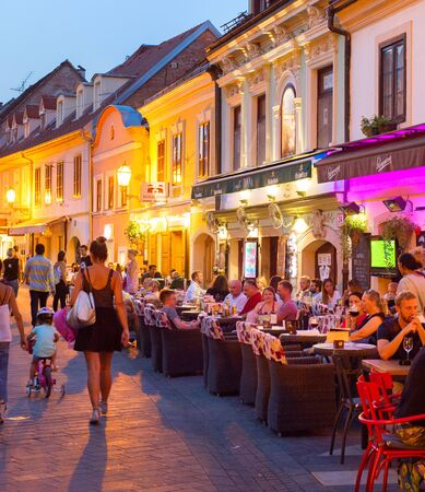 ZAGREB, CROATIA - AUG 25, 2017: Locals and tourists having a dinner at restaurants at Ivana Racica street. Zagreb is a capital and famous tourist destination in Croatia Редакционное