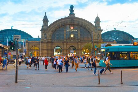 FRANKFURT, GERMANY - AUGUST 30, 2018: People walking in front of Frankfurt Main Train station. The station opened in 1899 and is the biggest in Germany