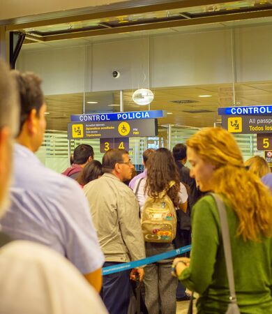 MADRID, SPAIN - MAY 23, 2017: People queue on passport control at arrival, Madrid airport, Spain Stock Photo - 128022931
