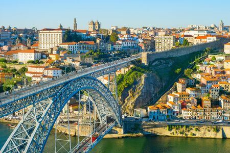 Old Town of Porto with Dom Luis I bridge in the morning light. Porto, Portugal Stock Photo