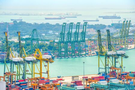 Singapore commercial port, shipping containers freight cranes, cargo equipment, skyline with ships and tankers in harbor